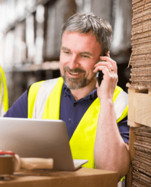 man in yellow vest on phone tablet version