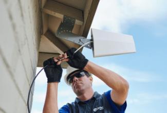 Man Installing Antenna